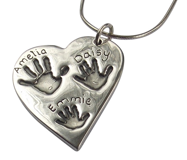 Solid silver hand print heart
